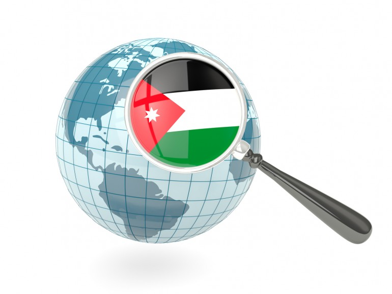Magnified flag of jordan with blue globe