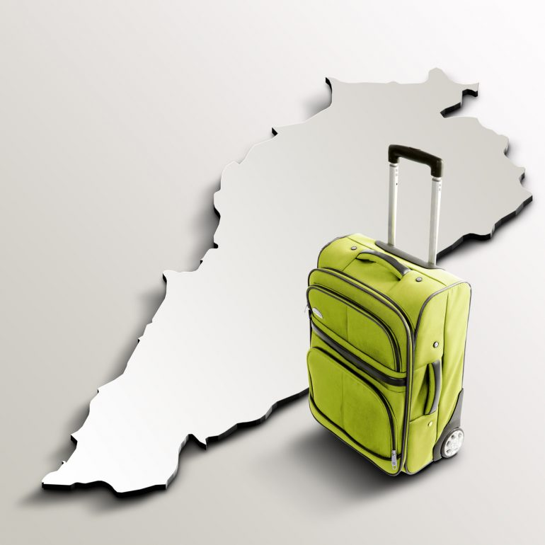 Travel to Lebanon. Green suitcase on 3d map of the country